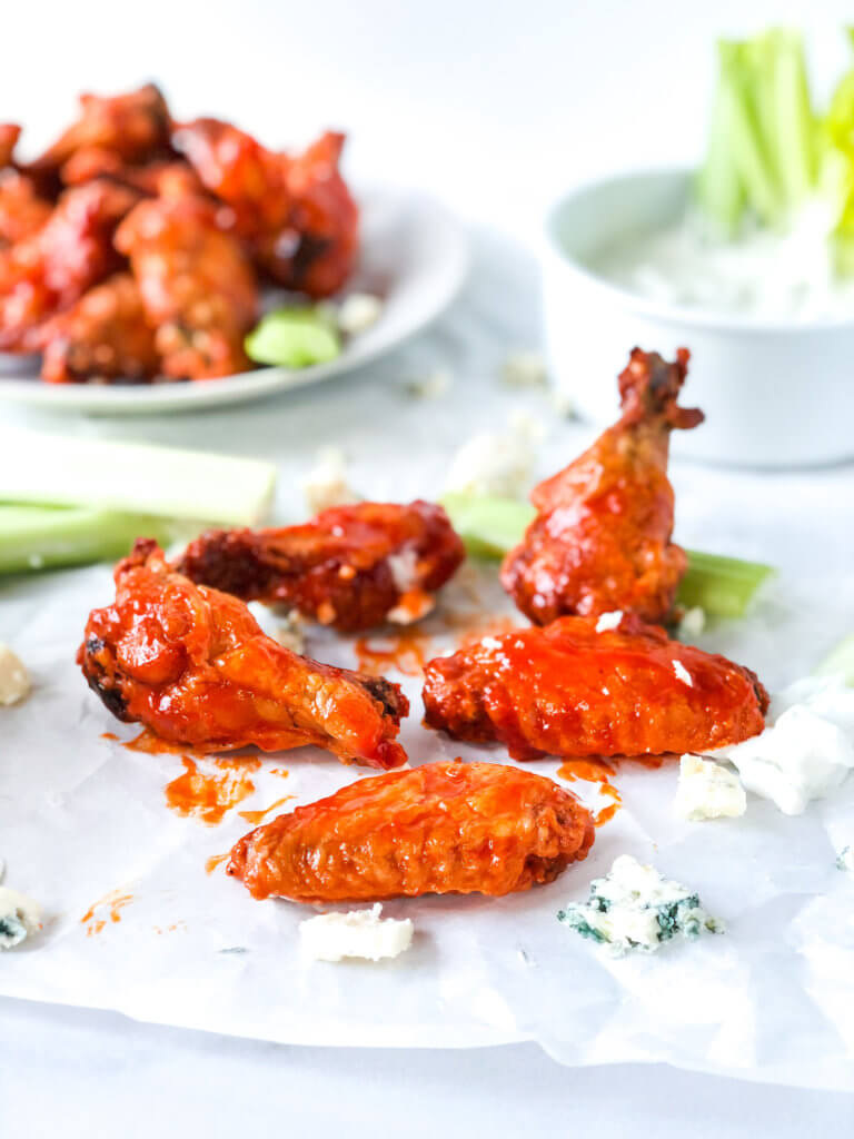 Oven fried chicken wings with buffalo sauce