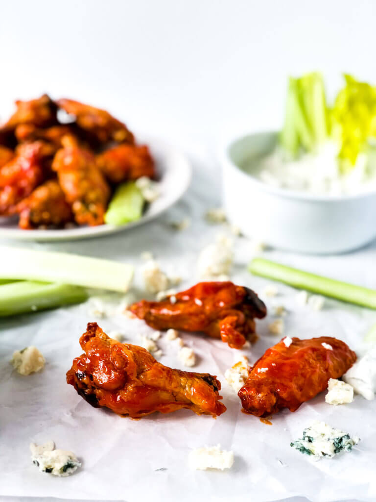 Crispy oven fried chicken wings with buffalo sauce