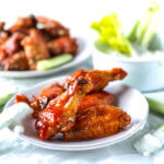 Oven fried chicken wings with hot sauce