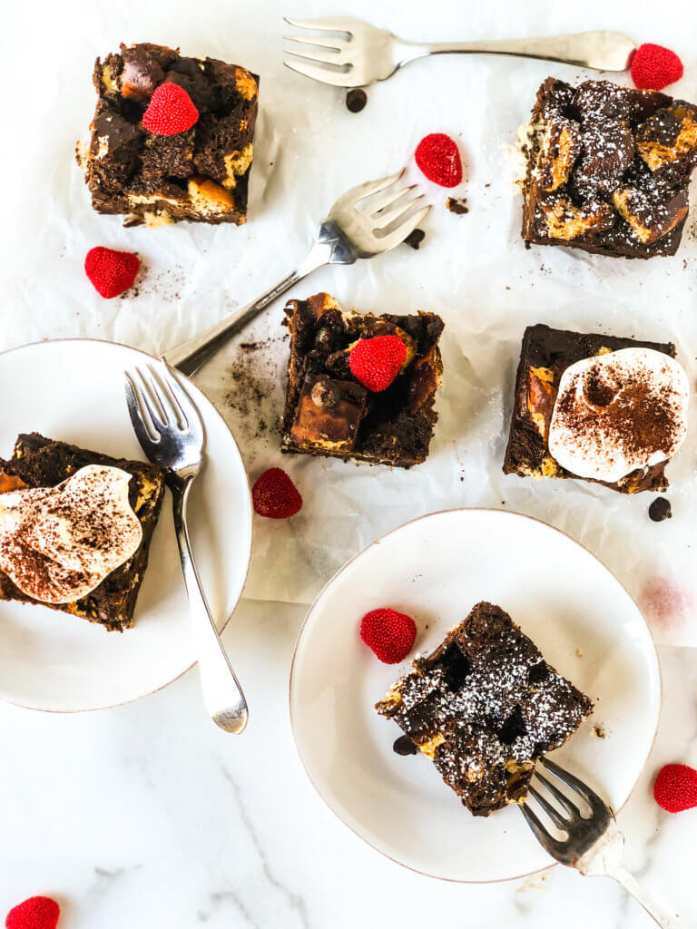 Six cliches chocolate bread pudding topped with whipped cream, or powdered sugar, or red hearts
