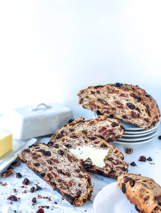 No knead bread with slices of bread, butter, and scattered dried cherries and chocolate