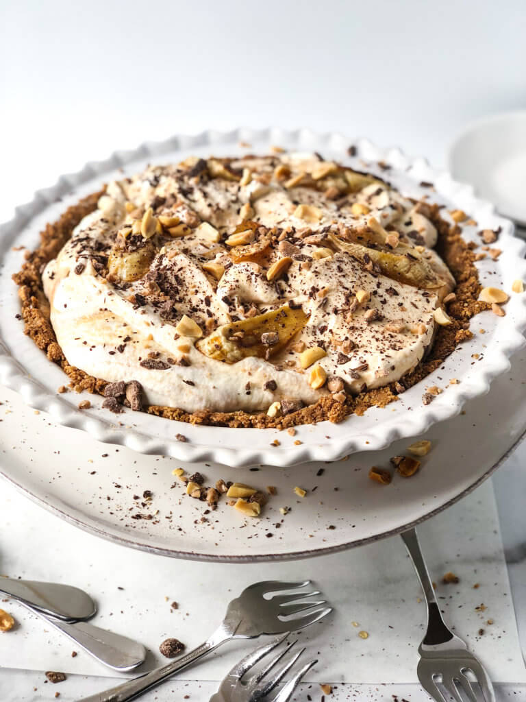 Shows 45-degree view of whole Peanut Banoffee Pie