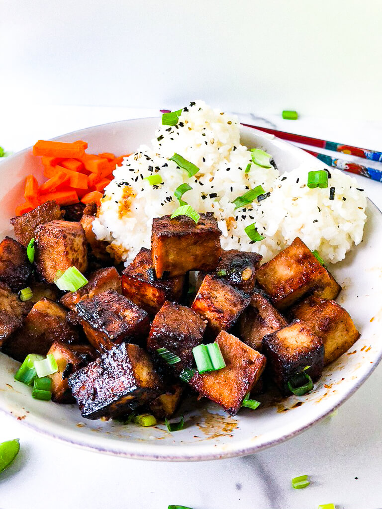 shows crispy marinated tofu with sticky rice
