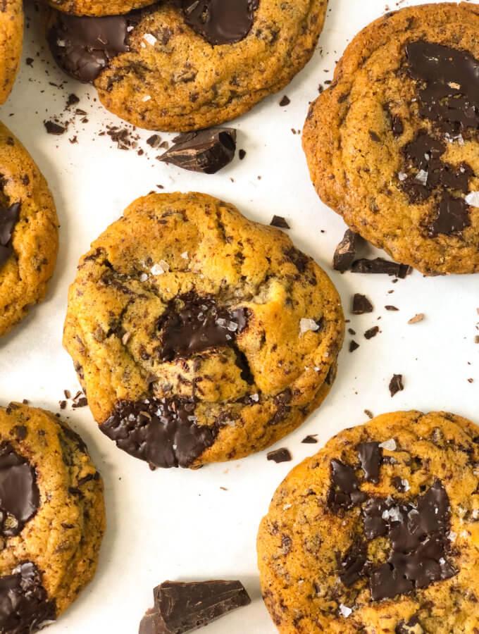 closeup of chocolate chip tahini cookie with flaky sea salt