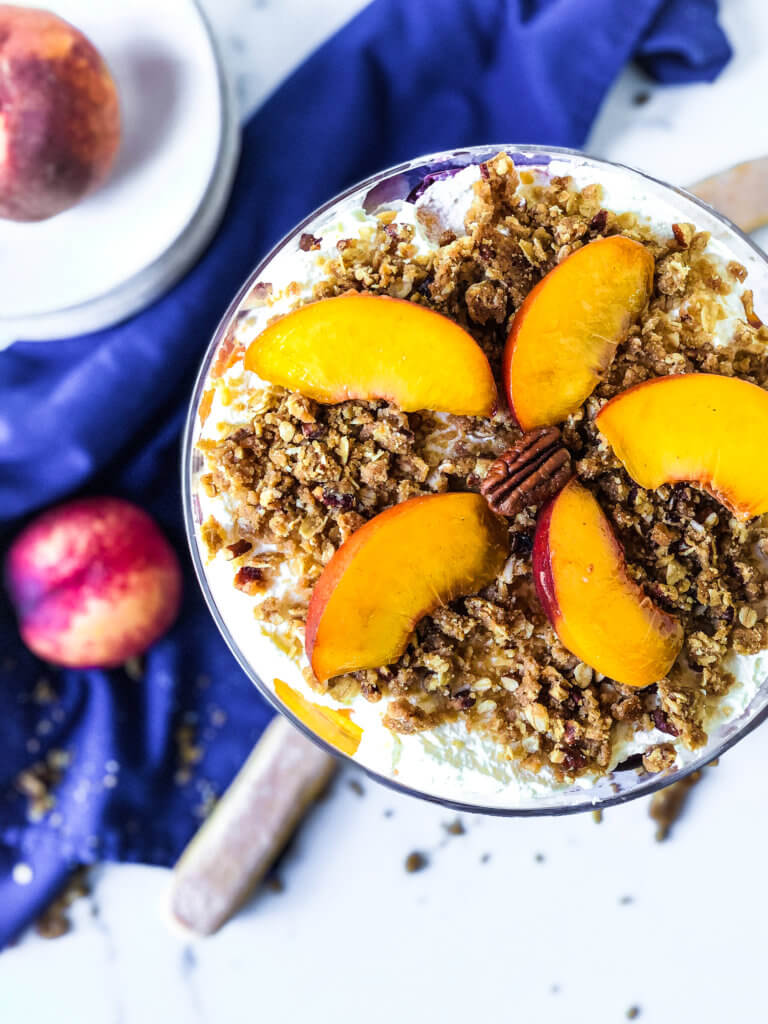 Top of Peach Crisp trifle garnished with fresh peach slices