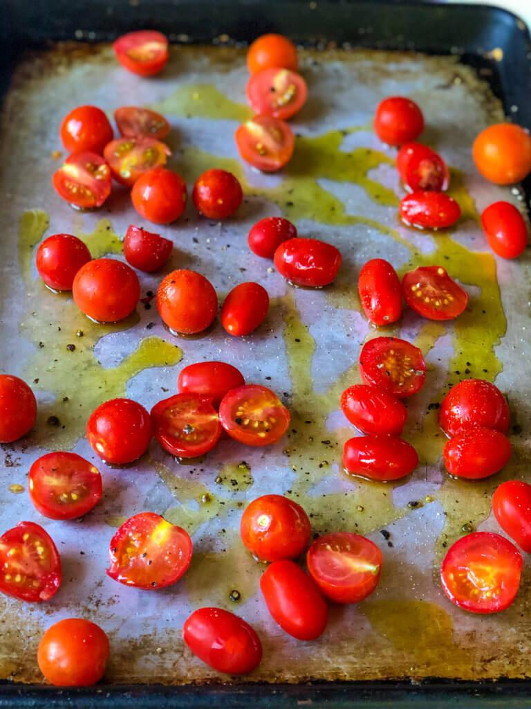 Olive oil, salt, pepper on cherry tomatoes