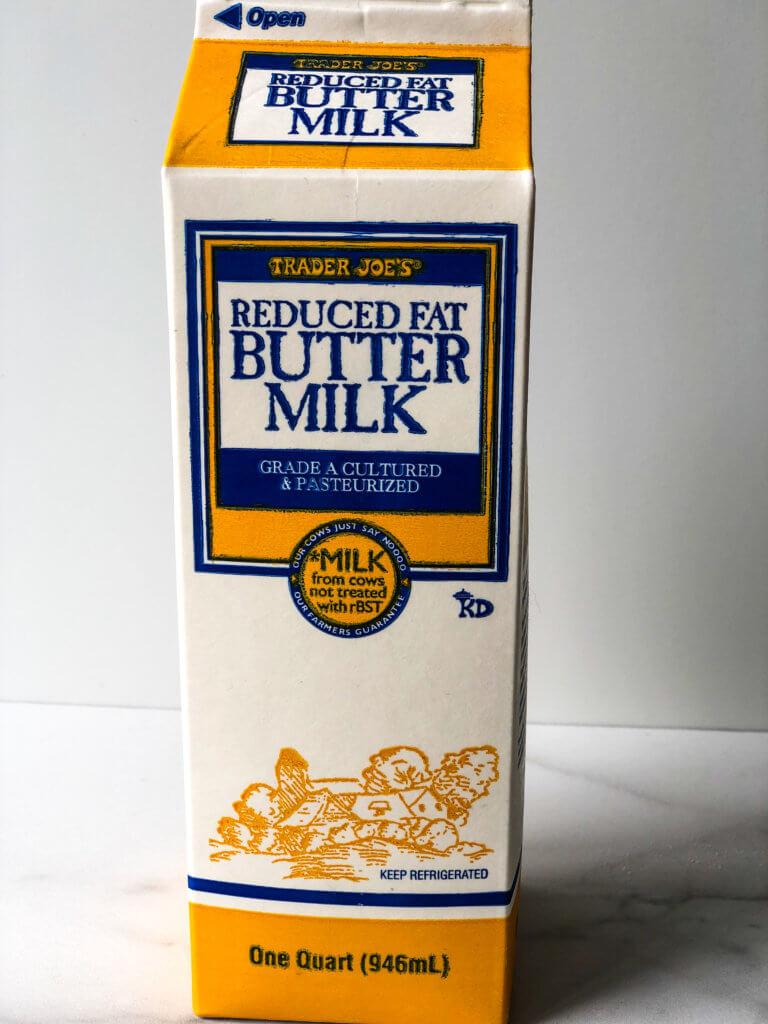 Process shot showing carton of buttermilk