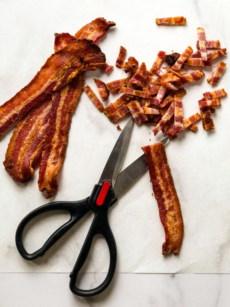Shows strips of bacon cut into tiny slices