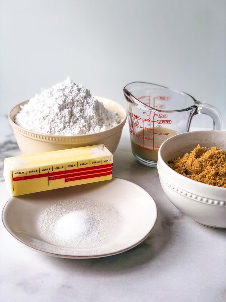 Process shot shows confectioners sugar, milk, brown sugar, salt, butter