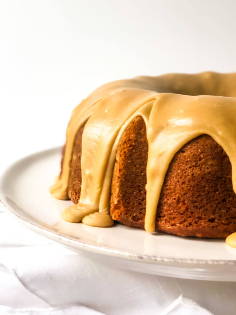 recipe featured image closeup of 1/2 Pumpkin bundt cake seen head-om
