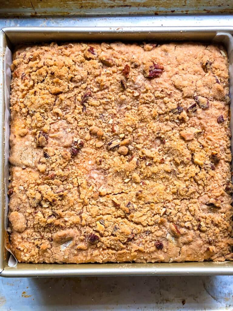 Process shot showing baked Sweet Potato Cheesecake Bars