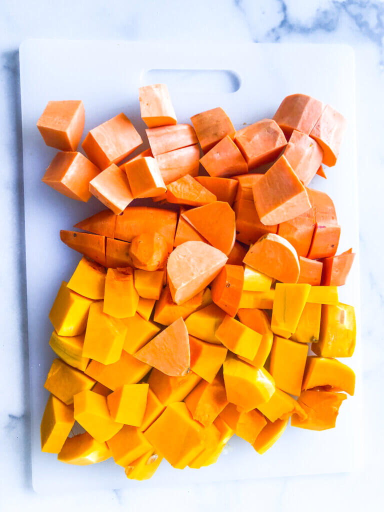 Process shot showing size - 1-2inch cubes- of sweet potatoes and butternut squash for soup making