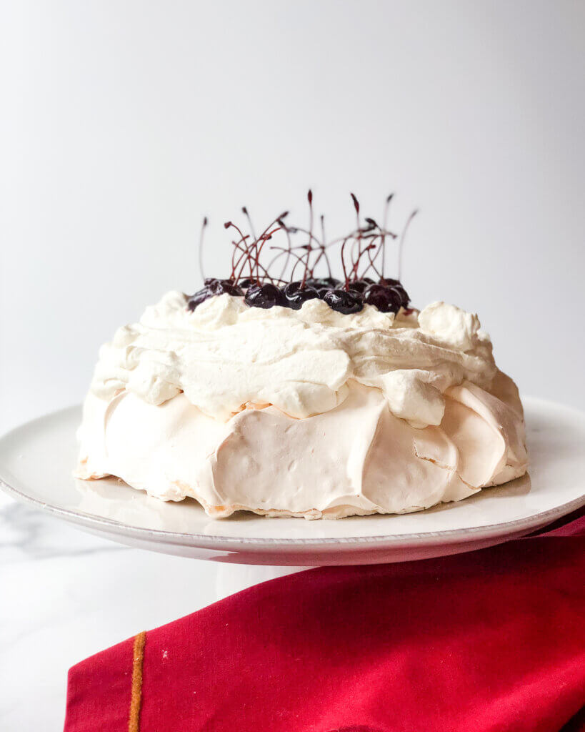 Pavlova with Mascarpone whipped cream and topped with amarena cherries