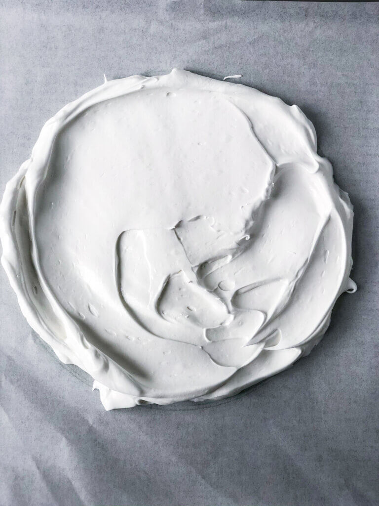 Overhead view of first layer of pavlova