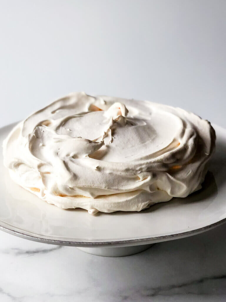 A fully baked pavlova shell should roughly retain its pre-baked shape but outsides should be crispy