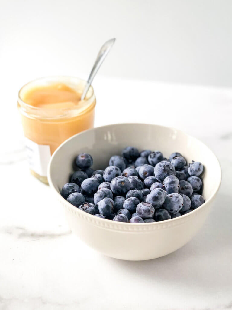 Ingredients in my Lemon Curd Pavlova include lemon curd and fresh blueberries. Blog post shows how to make this recipe!