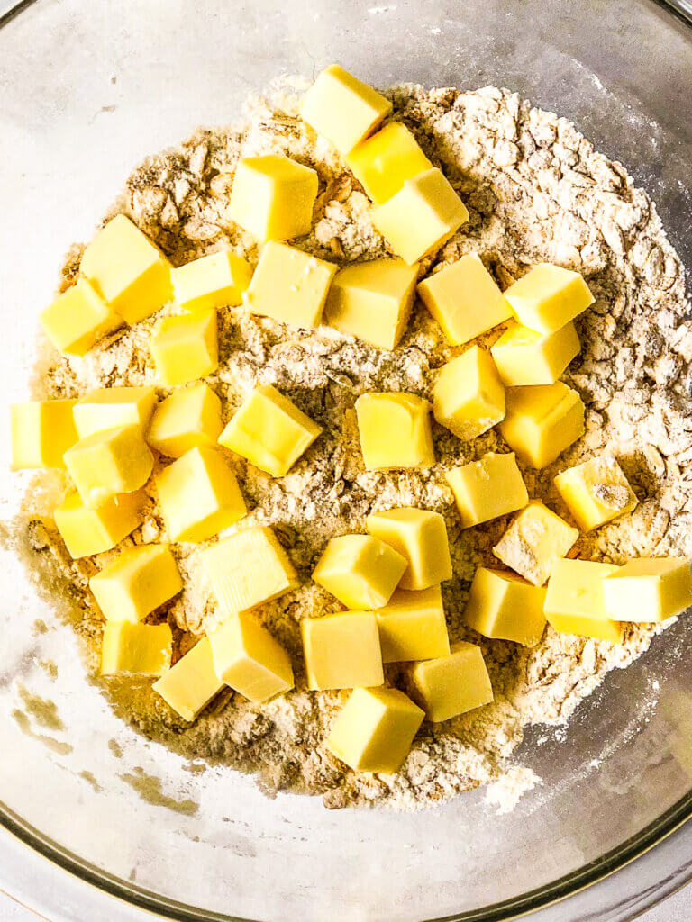 1 stick butter, cubed, sitting over the dry ingredients - process shot for recipe