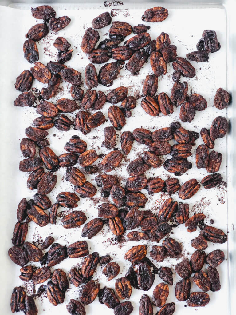 When making cocoa spicy pecans, spread coated nuts across parchment-lined baking sheet