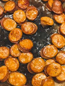Sauteeing Chicken Andouille until golden brown