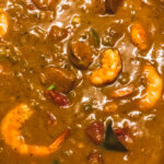 Thickened with file and roux, shrimp are cooked and gumbo ready to serve