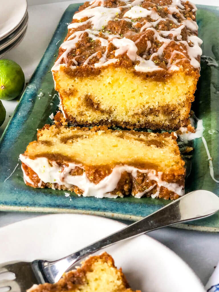 Shows layers of streusel and cake in Key Lime pound cake with streusel loaf