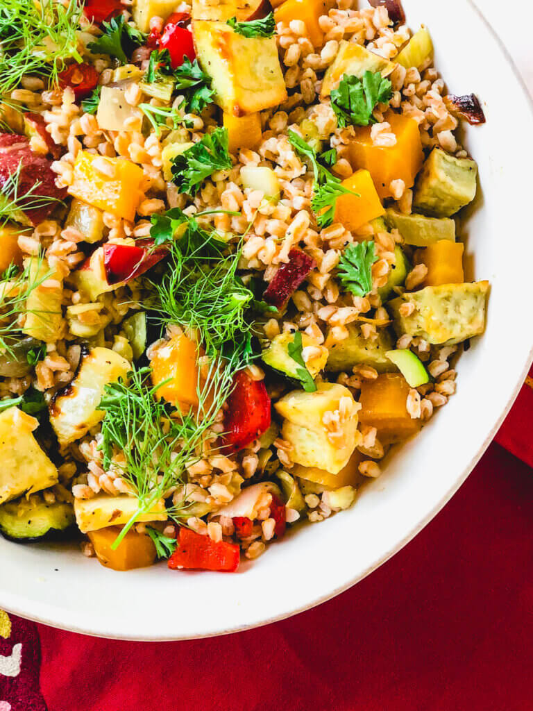 Roasted Vegetables and Farro make a beautiful, tasty salad. A simple orange and rice vinegar dressing adds so much bright flavor to this healthy salad!