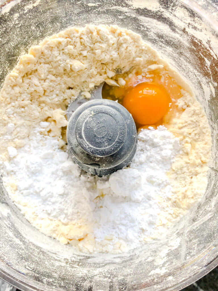 pulse in the egg and sugar, then drizzle water