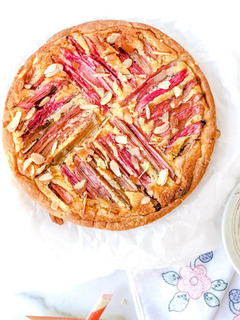 Rhubarb Frangipane Tart is a variation of the classic Bakewell tart. Adapted from a Mary Berry recipe this tart is filled with almond frangipane and topped with rhubarb and toasted almonds.