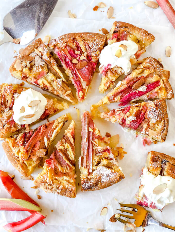 Rhubarb Frangipane Tart is an almond-filled tart, topped with rhubarb and sliced almonds. Indescribably delicious!