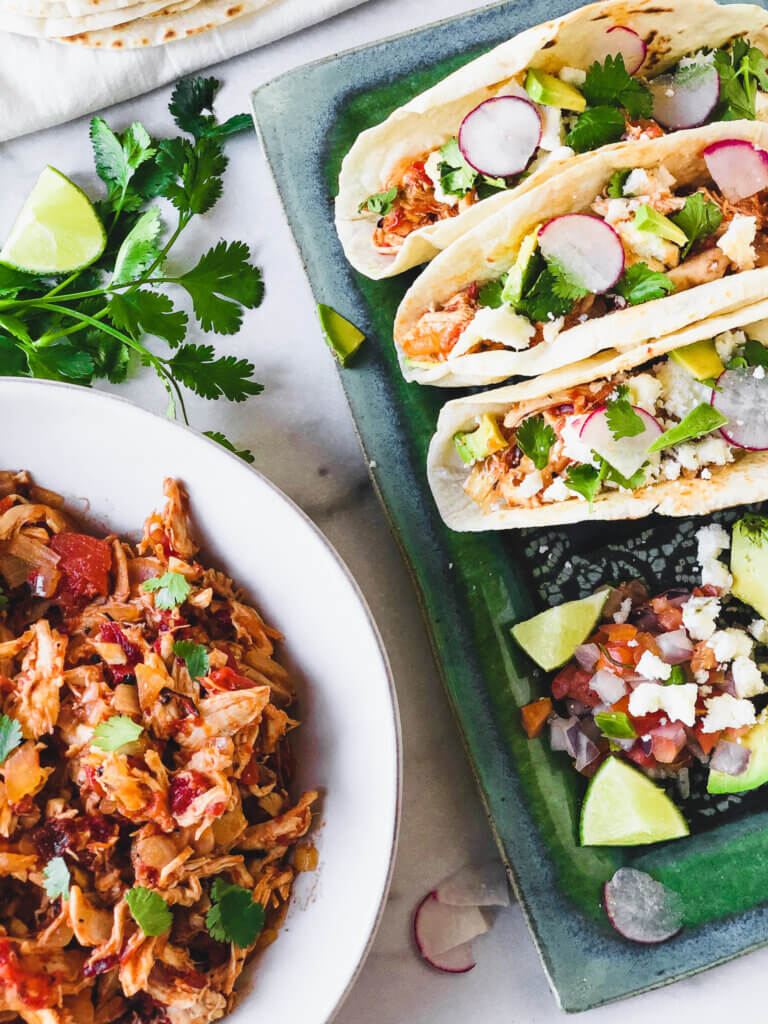 Chicken Tinga Taco Recipe - easy, just a few ingredients and a few minutes to make a classic Mexican taco filling!
