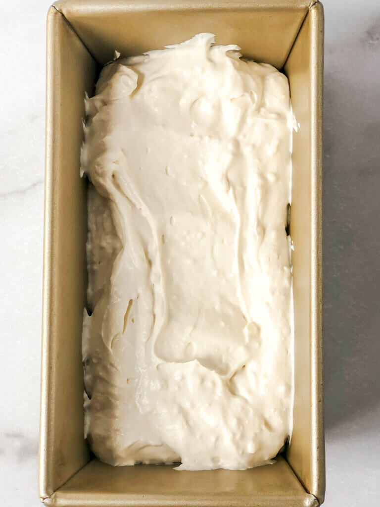 Add half the cream mixture to bottom of pan