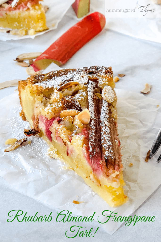 Rhubarb Frangipane Tart - a  beautiful Bakewell tart with orange accented almond filling, strips of rhubarb and roasted almonds. Indescribably delicious!