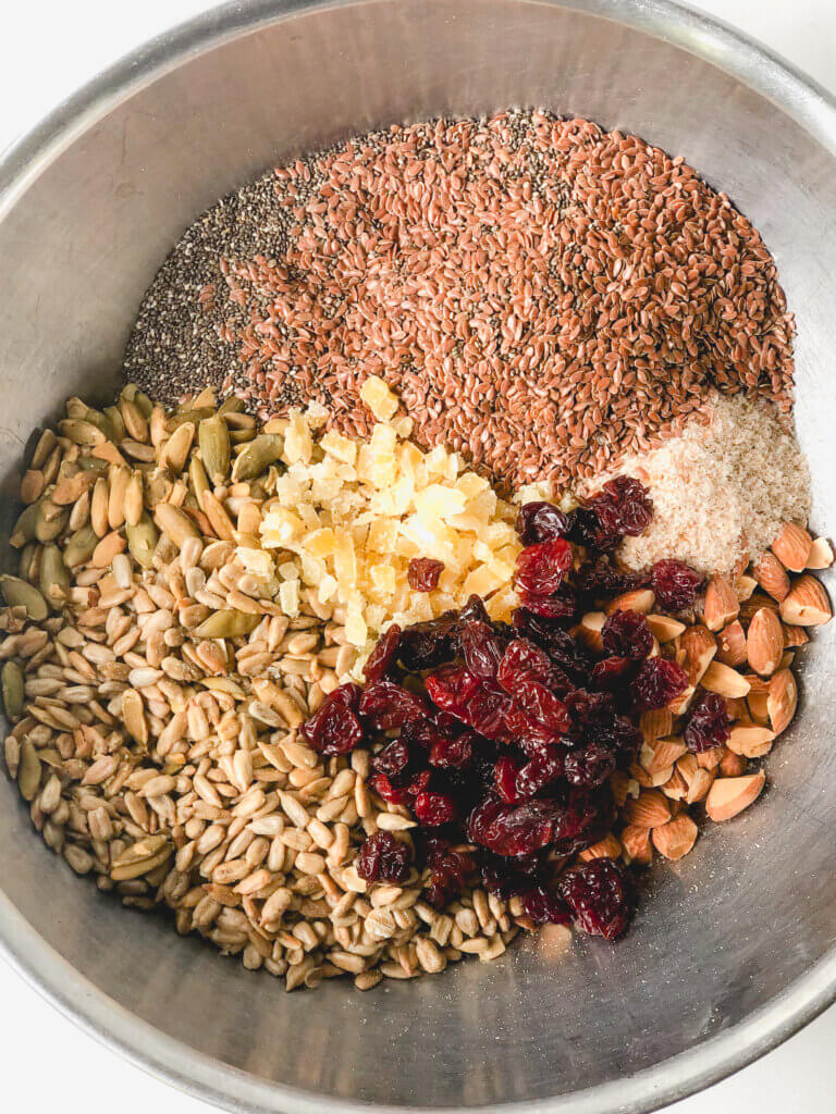 Ingredients for Adventure Bread: oats, chia seeds, flaxseeds, psyllium husks, almonds, dried cherries, sesame seeds, pumpkin seeds and crystallized ginger