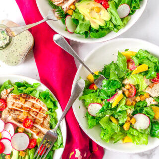 Lime Poppy Seed Dressing is tangy, sweet, creamy, the perfect compliment to salad of grilled chicken, avocado, mangoes and greens