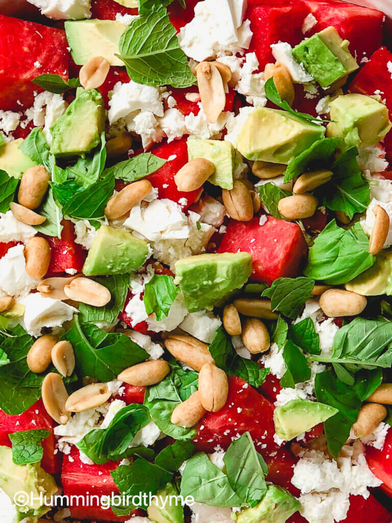 Flavor bomb of a salad! Watermelon Feta Salad with feta, avocado, roasted peanuts, topped with tangy lime dressing and fresh mint and basil
